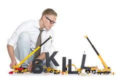 开发的技能: 生意人大厦技能字 免版税库存照片