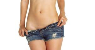离开她的牛仔布短裤的健康妇女 库存照片