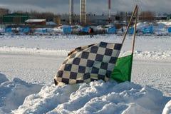 开始在雪困住的司法旗子 库存图片