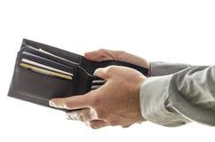 开张他的钱包的一个人 库存图片
