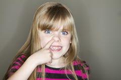 开掘为鼻涕的幼儿 免版税库存照片