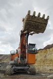 开放大转换挖泥机的最小值 免版税库存图片