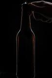 开放的啤酒瓶 免版税库存图片