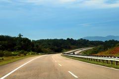 开放路在东海岸高速公路或Lebuhraya Pantai帖木尔 库存图片