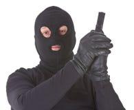 开枪他的查出的强盗 免版税图库摄影