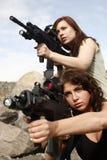开枪妇女 库存照片