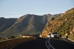 开汽车在一条风景高速公路南部非洲 库存照片