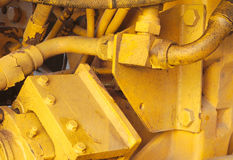 开汽车机械工黄色挖掘机拖拉机用内燃机特写镜头水力机器 免版税库存照片