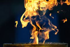 开火在蓝色背景 免版税库存照片