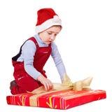 开玩笑与圣诞节礼物盒。 免版税图库摄影