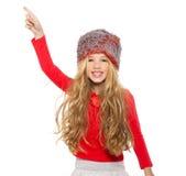 开玩笑女孩与红色衬衣和裘皮帽的冬天跳舞 库存图片