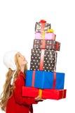 开玩笑拿着许多礼品的女孩被堆积在她的现有量 图库摄影