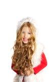 开玩笑有圣诞节冬天白色毛皮的小女孩 免版税库存照片