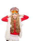 开玩笑有雪冬天玻璃和空白毛皮的女孩 图库摄影