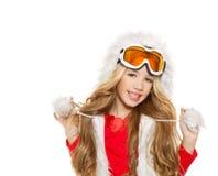 开玩笑有雪冬天玻璃和空白毛皮的女孩 库存照片