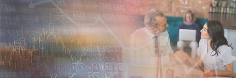 开的商人与数字的一次会议计算转折作用 图库摄影