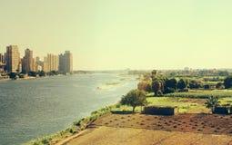 开罗市耸立,并且农夫调遣,埃及 库存照片