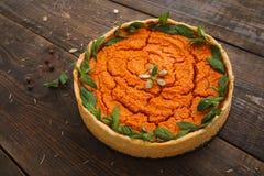 开胃南瓜饼用在木头的薄菏 免版税库存图片