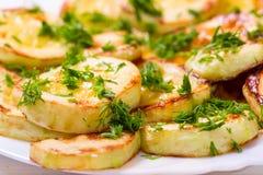 开胃南瓜,油煎在油和撒布与gree 免版税库存图片