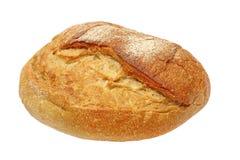 开胃嘎吱咬嚼的外壳面包被采取的特写镜头。隔绝。 库存照片