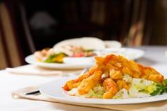 开胃在表上的鱼主菜 免版税库存图片