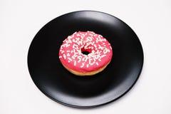 开胃多福饼与洒在一块黑陶瓷板材的谎言 免版税库存照片