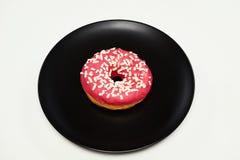 开胃多福饼与洒在一块黑陶瓷板材的谎言 免版税库存图片