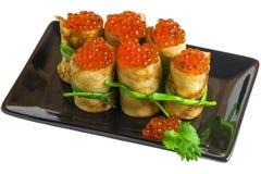 开胃服务用薄煎饼和鱼子酱 免版税库存图片