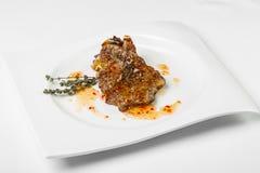 开胃肉用在方形的板材的调味汁在白色背景 免版税库存照片
