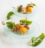 开胃菜用瓜和熏火腿 库存照片