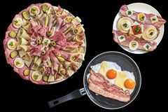 开胃菜盘用在煎锅的煎蛋烟肉和乳酪用在黑背景隔绝的食家三明治和烟肉更卤莽 免版税图库摄影