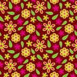 开花与绿色和桃红色花的无缝的样式在墙纸的红色背景 免版税图库摄影