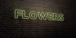 开花-在砖墙背景的现实霓虹灯广告- 3D被回报的皇族自由储蓄图象 免版税图库摄影