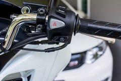 开-关摩托车把手虚度光阴的中止,应急灯按钮 图库摄影