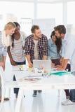 开年轻的设计师愉快的队会议 免版税库存图片