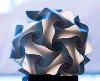 异常的纸被折叠的灯罩 库存图片