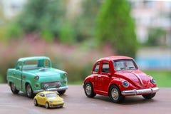 式样玩具汽车,但是木表面 图库摄影