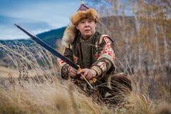 弓亚洲人猎人 免版税库存图片