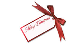弓圣诞节停止的节假日红色标签附加 库存图片