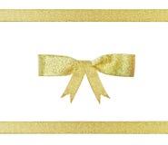 弓圣诞节金黄丝带 免版税库存照片