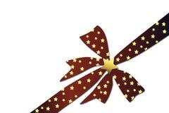 弓圣诞节金黄红色星形 免版税库存照片
