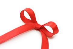 弓红色缎子的磁带 免版税库存图片