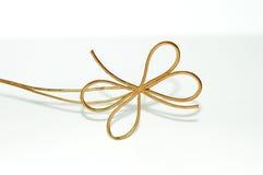 弓蝴蝶装饰金子白色 库存照片