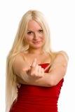 引诱的金发碧眼的女人穿戴了您的头发的长的红色 免版税图库摄影