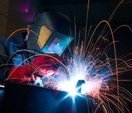 引起焊工 图库摄影