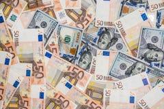 50张欧洲和100美元钞票 库存图片