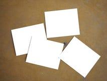 4张空白的照片和黄色背景 免版税库存照片