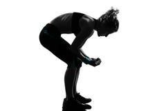 弯曲的健身姿势拱形屋顶妇女锻炼 免版税库存照片
