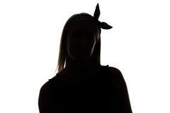 弯曲的妇女剪影有丝带的 免版税库存照片