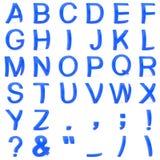 从弯曲的3D大写字母的蓝色字体 库存照片